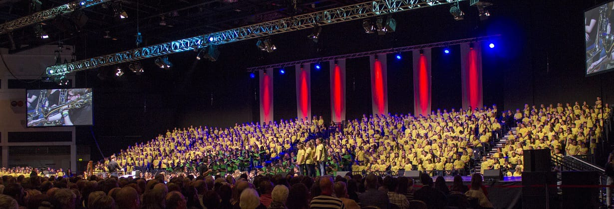 A photo from our 1000 Voice Choir event in December 2014.